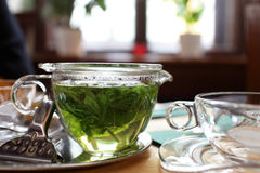 Cup of mint tea on a table Stock Images