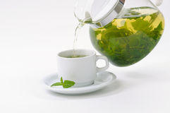 Cup with mint tea and teapot royalty free stock photos