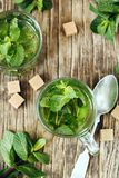Cup of Mint tea on wooden background stock photos