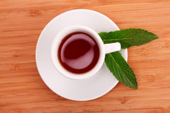 Cup  with mint on wooden Royalty Free Stock Image