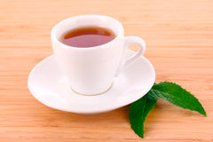 Cup  with mint on wooden Royalty Free Stock Photos