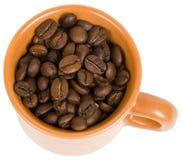 Cup mit Kaffeebohnen Lizenzfreie Stockfotos