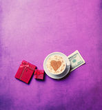 Cup, money and gifts Stock Photo