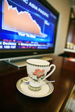 Cup with monitor show chart. Cup with monitor which show financial chart Stock Image