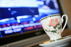 Cup with monitor show chart. Cup with monitor which show financial chart Stock Photos