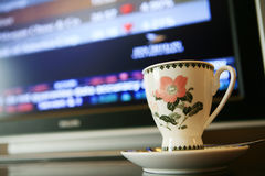 Cup with monitor show chart. Cup with monitor which show financial chart Stock Images