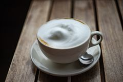 Cup of morning cappucino. On rustic wooden table  with copy space royalty free stock photography
