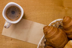 Cup of morning coffee and croissants Stock Images