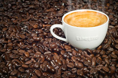 Cup of Morning Espresso in Roasted Coffee Beans Stock Photos