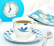 Cup of morning tea and alarm clock Royalty Free Stock Photo