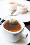 Cup of morning tea and two cakes on a plate Royalty Free Stock Photo
