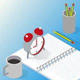 Cup mug and alarm clock on the table Royalty Free Stock Image