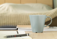 Cup mug on the table in bedroom. Royalty Free Stock Photo