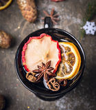 Cup of mulled white wine on dark wooden background with snow Stock Image