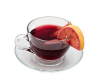 Cup with mulled wine. Clear cup with hot red wine and fruit royalty free stock photography
