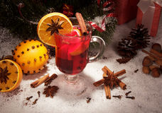 Cup of mulled wine, anise and other spices Stock Image