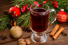 Cup of mulled wine, candle and christmas ball Stock Image