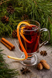 Cup of mulled wine and cinnamon Stock Image