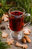 Cup of mulled wine and cookies Stock Images