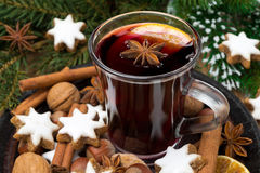 Cup of mulled wine, cookies in the shape of stars and spices Royalty Free Stock Image