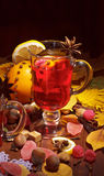 Cup of mulled wine with lemon slice and anise Stock Images