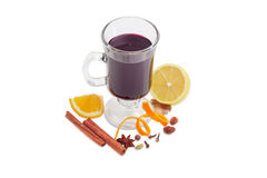 Cup of mulled wine and mulling spices on light background Stock Images