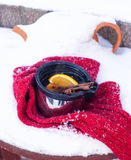 Cup of mulled wine on snow covered Stock Photography