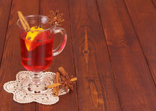 Cup of mulled wine that stands on lacy napkin Stock Photos
