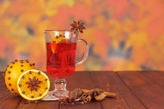 Cup of mulled wine on a wooden table with spices Royalty Free Stock Photography