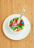 Cup with multicolored tablets and hermometer Stock Photos