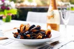 Mussels and white wine Stock Photo