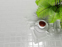 A cup on the napkin Royalty Free Stock Photos