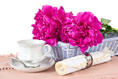 Cup, napkin and peonies Stock Image