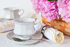 Cup, napkin and peonies Royalty Free Stock Image
