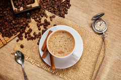 A Cup of natural coffee, coffee beans, Arabica, cinnamon stick. Aromatic coffee, natural grain, Arabica. Shows a hot Cup of coffee, coffee beans, hand grinder stock photos