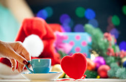 Cup near a heart shape toy Stock Photo