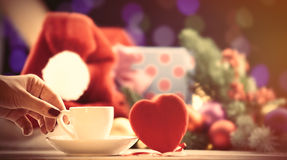 Cup near a heart shape toy Royalty Free Stock Image