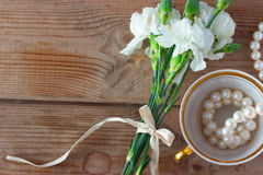 Cup necklace and white flowers Royalty Free Stock Photos