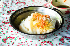 The Cup Of noodle eaten with powdered shrimps and pineapple slices. Royalty Free Stock Photos