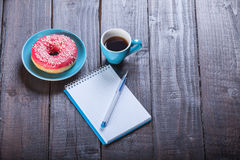 Cup, notebook and donut Royalty Free Stock Photo