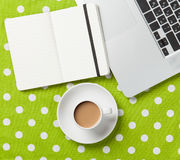 Cup and notebook near laptop comuter Stock Images