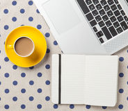 Cup and notebook near laptop comuter Royalty Free Stock Photo