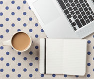 Cup and notebook near laptop comuter Royalty Free Stock Photos
