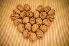 Cup of nuts on bamboo table cloth Stock Photo