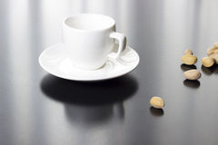 Cup and nuts Stock Photography