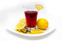 Cup o tea and lemons on white background Stock Images