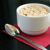 A cup of oatmeal. Porridge Stock Photos