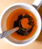 Cup Of Black Tea With Brew And Spoon Top View Stock Photography