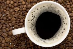Cup Of Coffe And Coffee Grains Stock Image