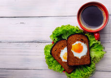 Free Cup Of Coffe And Two Fried Eggs In Toast On The Salad.Top View . Stock Images - 72460294